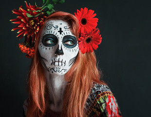 photo portrait of red haired girl with red flowers in her hair makeup Los Muertos