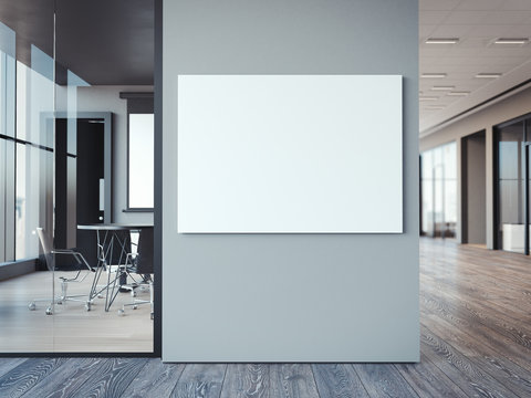Empty white canvas on the office gray wall. 3d rendering