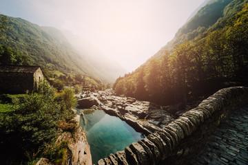 Panoramic Double arch stone bridge at Ponte dei Salti with waterfall, Lavertezzo, Verzascatal, Canton Tessin.