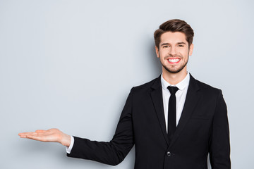 Cheerful happy businessman making presentation of new product
