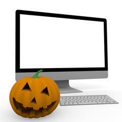 personal computer and halloween pumpkin