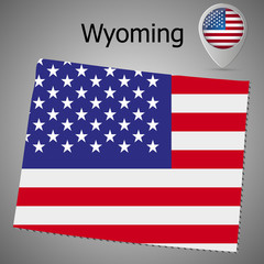 Wyoming State map with US flag inside and Map pointer with American flag.