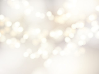 Vector bokeh background. Festive defocused white lights. Abstract blurred illustration.