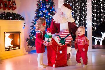 Kids and Santa opening Christmas presents