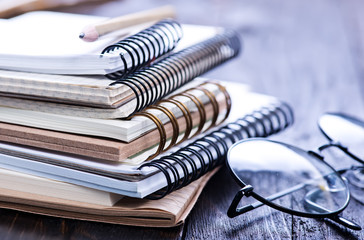 Stack of spiral notebooks