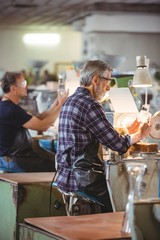 Glassblowers working on a glass