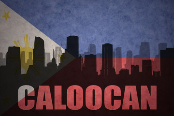 abstract silhouette of the city with text Caloocan at the vintage philippines flag background