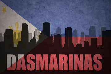 abstract silhouette of the city with text Dasmarinas at the vintage philippines flag background