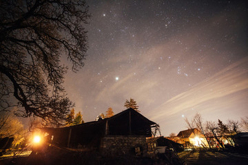 Starry night over country home