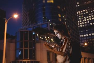 Young woman using digital tablet Fotomurales