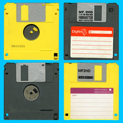 Yellow and black floppy disks isolated