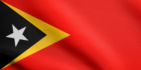 Flag of East Timor waving with fabric texture