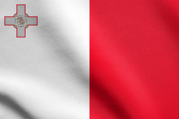 Flag of Malta waving with fabric texture