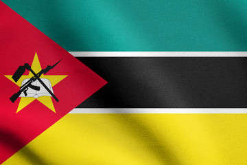 Flag of Mozambique waving with fabric texture