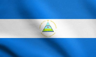 Flag of Nicaragua waving with fabric texture