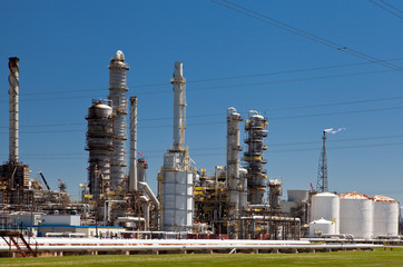 Industrial Petroleum Refinery Plant Smokestacks and Piping