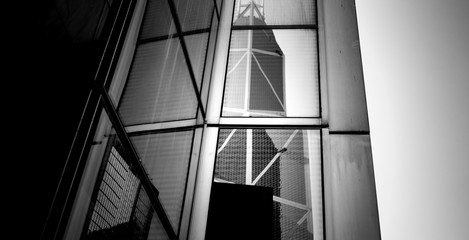 windows of business building in Hong Kong with B&W color
