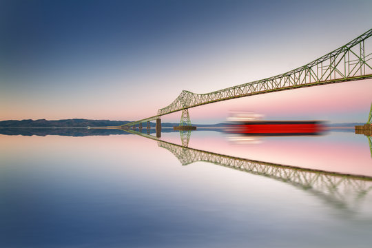 Fine art bridge and ship in clear sky with reflections