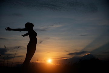 silhouette woman happy and sunset