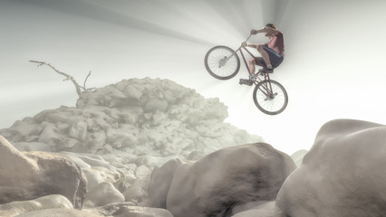 Cyclist climbing on a rock.