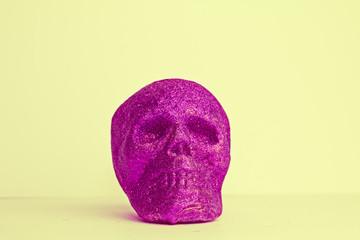 Single Purple Halloween Glitter Skull on Yellow Background