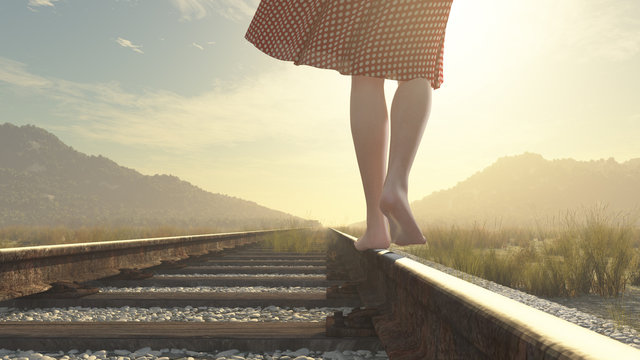 A walking barefoot girl on the railway