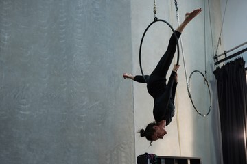 Female gymnast performing acrobatic gymnastics on hoop
