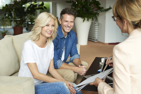 Professional businesswoman and her client. Shot of an insurance agent sitting at office with her client and consulting.
