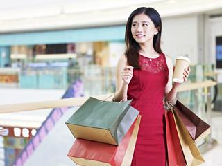 young beautiful asian woman shopping in mall
