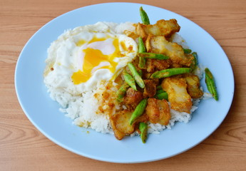 spicy stir fried crispy pork and yard long bean in curry and creamy egg yolk