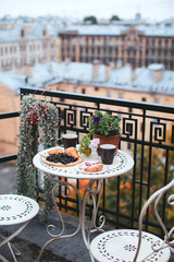 breakfast pastries with tea and grapes on the balcony overlooking the city