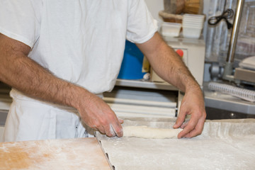 baker making bread , man hands , kneading a dough , cooking coat