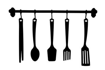 Black and white image of kitchenware set.