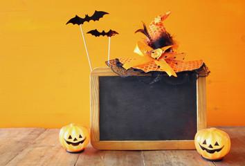 Halloween concept. Cute pumpkin on wooden table