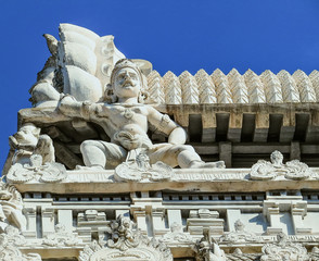 Statue of indian mythological hero on the corner of the roof of one of the Gopuram of ancient temple Arunachaleswara, XVI century. Tiruvannamalai, South India.
