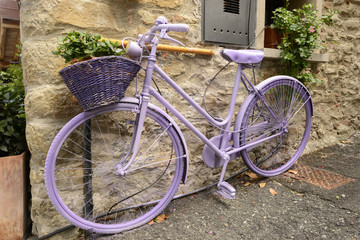 old bike painted lilac at lerma, Italy