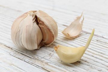 Garlic on a white wooden board