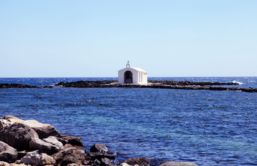 Small white church in sea near Georgioupolis, Crete, Greece