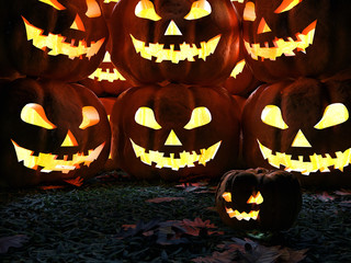 Halloween pumpkin in the night park on grass and autumn leaves. Group of Scary Jack O Lantern and a small pumpkin. All Hallows' Eve holliday 3d illustration