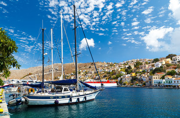 Foto op Aluminium Stad aan het water Boats in the harbor of Symi Island. Greece, Europe