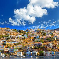 Wonderful Greece. Island Symi. Dollhouses cloud bright day