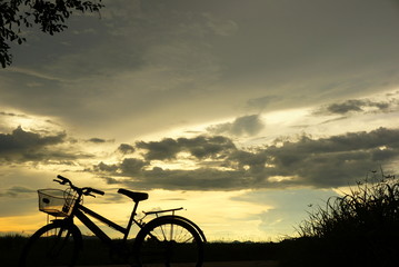 bicycle sillouette at sunset nature background