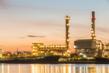 Oil refinery plant at dusk.