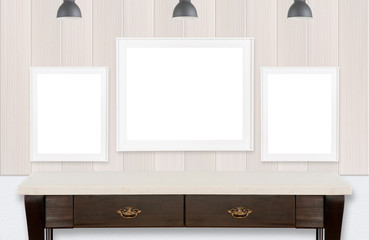 Three picture frames on wood wall and white background