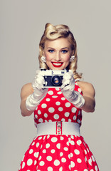 woman, with no-name camera, taking picture, dressed in pin-up st
