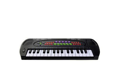 Toy keyboard isolated on white background.