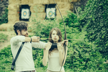 Attractive couple shoots out of the bow