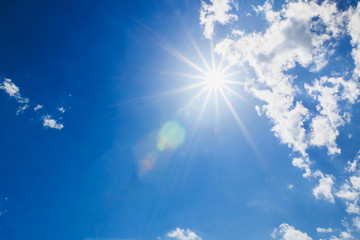 Sun rays on blue sky background with beautiful