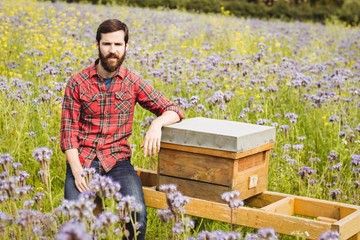 Portrait of beekeeper sitting on beemate