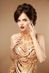 Elegant woman in gold dress, fashion lady in expensive pendant j